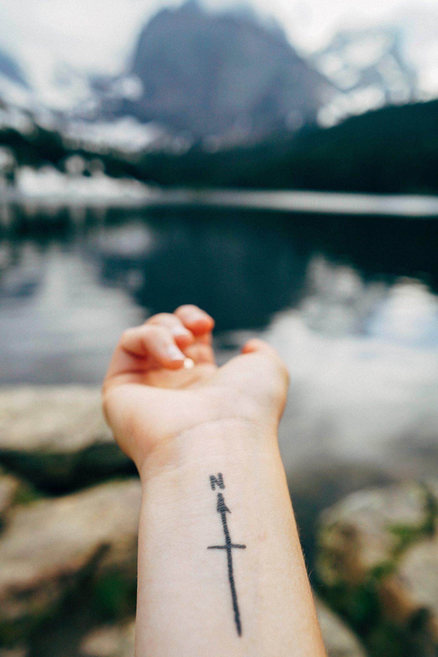 north tattoo in arm